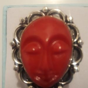Hand carved face ring size 7 and 3/4 new